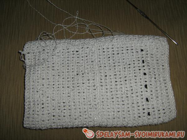 Knitted cover with decorating on the tablet