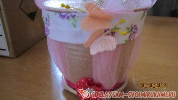 decorated with fabric flowers and butterflies