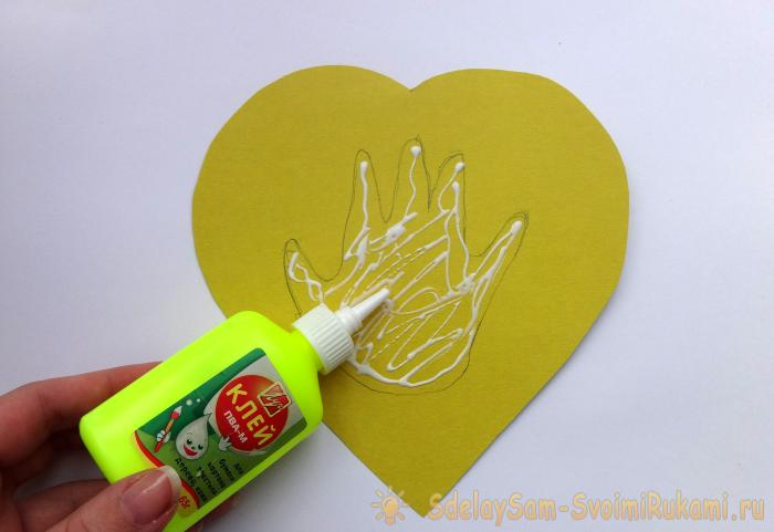 Postcard Heart with a child's hand