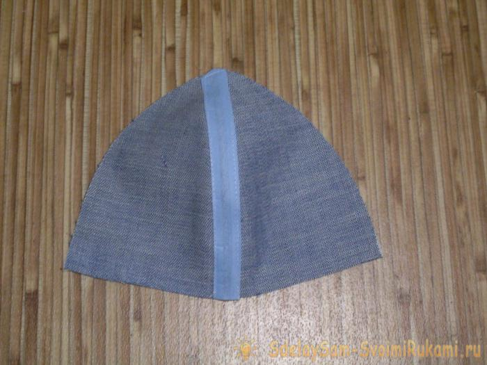 We're sewing a denim a baseball cap for a baby