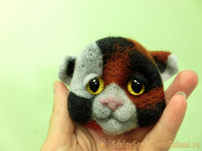 spotted cat made of wool felting