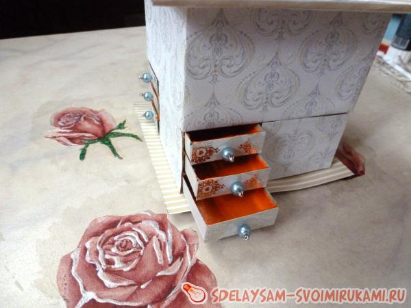 A miniature chest of drawers