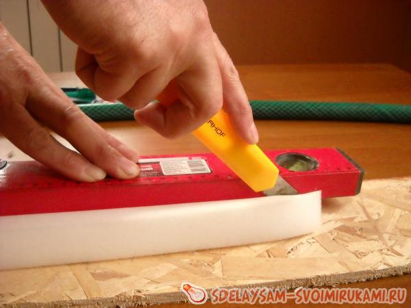 Cut a strip of foam rubber