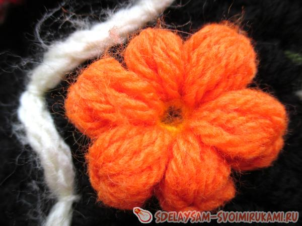 A lush flower is knitted