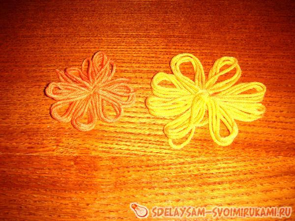 make a flower out of an orange thread