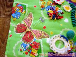 Sewing developing textile mat for girls