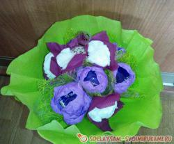 A small bouquet of sweets, crocuses made of corrugated paper