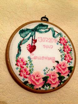 Cross-stitch embroidery design in art hoop-art