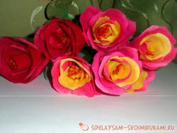 Bouquet of roses from candies and specks paper