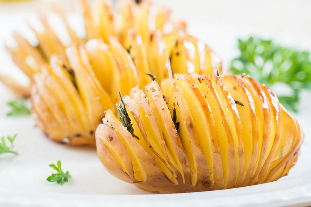 Baked Hasselback potatoes with garlic and thyme