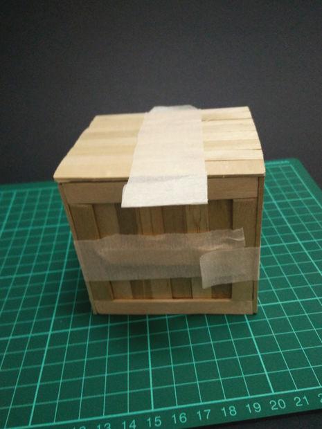 A miniature box of ice cream sticks