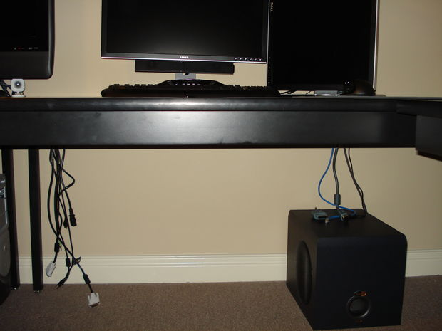 Hide the wires under the computer table
