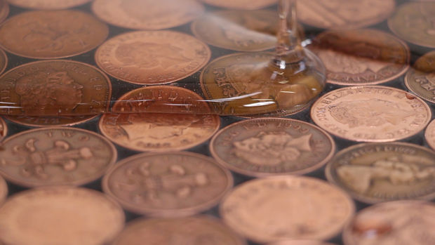 The floor of the coins under the epoxy resin