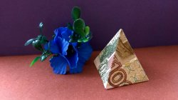 Origami pyramid is a model from a bank note with own hands