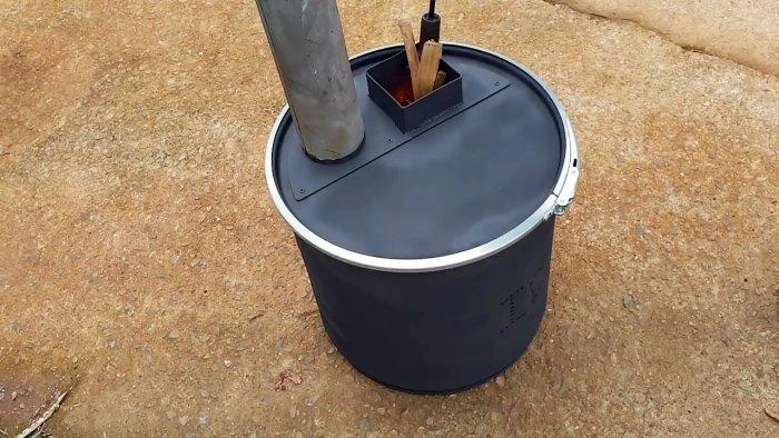 Как сделать печь с вертикальной загрузкой из металлического бака